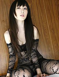 Slender Asian Seductress Flaunts Her Butt