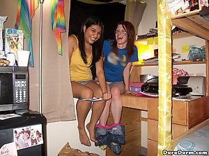 Check out these hot fucking college babe show her tits at a football game then get rammed 3some style in these hot dorm room party pics