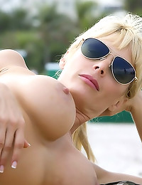 Big tits blonde beach goddess