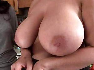 Big titty blonde in kitchen