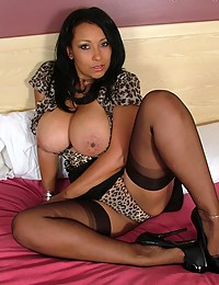 Well-developed super hot chocolate lady in black stockings getting undressed and teasing you