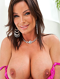 Classy brunette with big tits