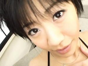 Saya Misaki Pretty girl in a bikini plays her titties and a cock