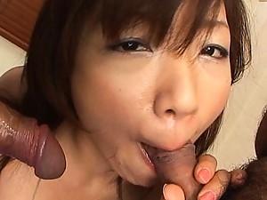 Mitsu Anno hottie sucks two hard cocks at the same time