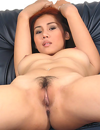 Dildo in an Asian pussy