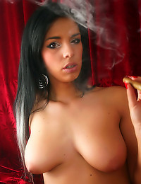 Brunette smokes a cigar