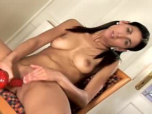 Hot Brunette Reaches Climax with her Red Sex Toy