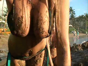 Lia 19 - These two young hotties don't mind getting dirty every once in a while - watch them smear their big bare curves with soil at the public beach!