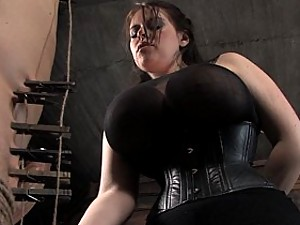 Gorgeous huge tits on Dominatrix beats slave boy and face sits