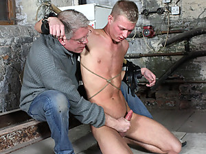 Sebastian has a real cutie on his hands with 19-year-old Cameron Wilson. Looking weak and helpless, Sebastian brings the pathetic lad back to life with a powerful flogging which soon has Cameron pleading for it to end. Sebastian strokes the lads hard cock