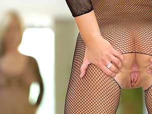 Alison Angel - Alison Angel knows how to spice things up, she slipped into a tight crotchless fishnet bodysuit in front of the camera.