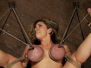 Hot blond MILF has her monstrous tits brutally bound to her ankles and knees, is caned, finger fucked and made to squirt and cum over and over.