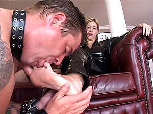 He licks the feet of the latex woman