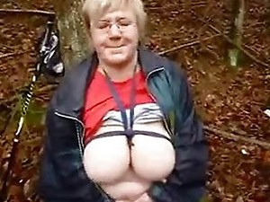 Horny granny slut masturbates in wood